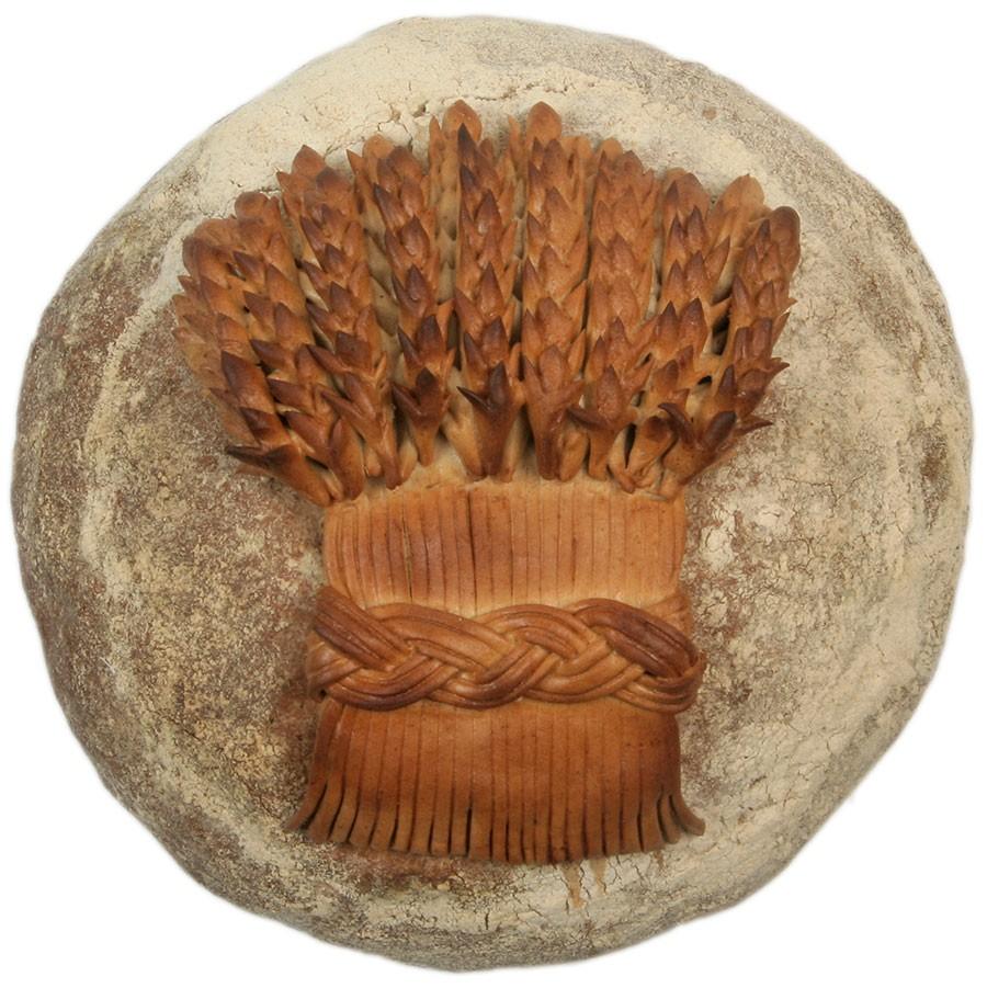 Dekoretat surdegsbröd som kan beställas till Sverige från franska Poilânes webbutik.
